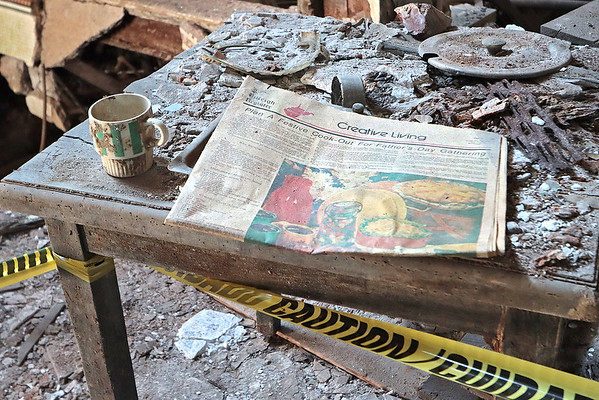 A newspaper dated 1981 sits on a desk in the Wyoming Hotel in Mullens. The building, which has stood empty since the 1980's, was donated to the town and several organizations would like to see it restored to a hotel and restaurant. Renovations on the building will begin in September but additional funding is needed to complete the project. Jenny Harnish/The Register-Herald