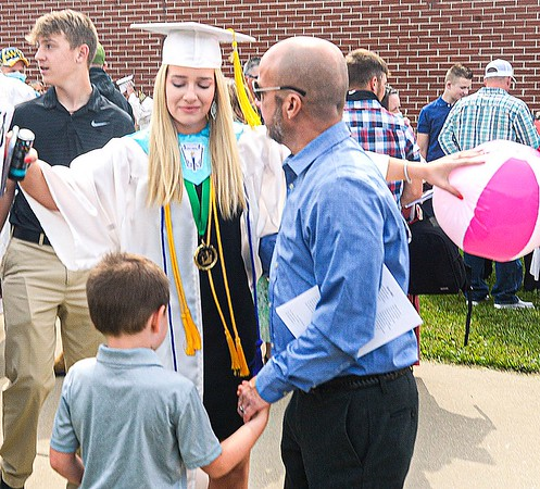 F. Brian Ferguson/Register-Herald  Liberty High School Graduate Alyssa Williams celebrates with her family after Saturday's Commencement at the Beckley=Raleigh County Convention Center.
