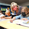 Katie Cooper, 3rd grade teacher Crescent Elementary School, third from left, work with her student, Ali Radford, left, Candid Legg and Sadie Beasley,Tuesday morning during the first day of school in Raleigh County.<br /> (Rick Barbero/The Register-Herald)