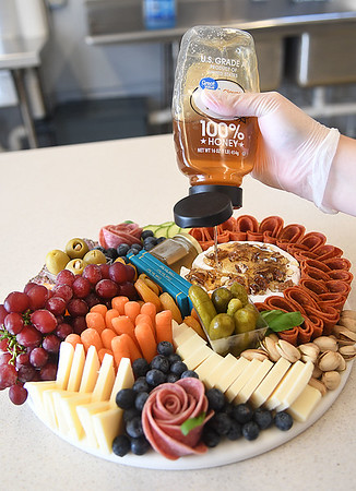 Piper Burgess, owner, Gourmet Grazing in Crab Orchard, preparing a Charcuterie Board.<br /> (Rick Barbero/The Register-Herald)