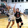 Wyoming East's Skylar Davidson drives in for two against Riley Lucas, of Chapmanville.<br /> Jim Cook/for the Register-Herald