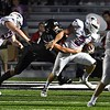 Atticus Goodson, of Independence, pulls away from aLiberty defender in the first quarter at Liberty High School Friday night.<br /> (Rick Barbero/The Register-Herald)