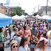 A block party for the inaugural Greenbrier Valley Pride Court event on Court Street in downtown Lewisburg was crowded after the parade Saturday.  Jenny Harnish for the Register-Herald