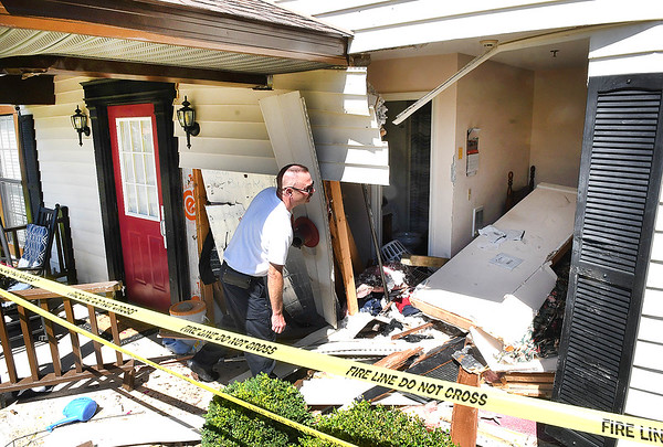 Beckley Fire Department Captain Gregg Blevins, looks over the damage done on the front of The Bayberry Retirement Inn on 408 Timberidge Drive in Beckley after a truck crashed into the structure Tuesday monring.<br /> (Rick Barbero/The Register-Herald)