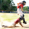 Brandon Wiley of Bluefield slides safely into home under Independence catcher Caleb Daniels for the first run of the game.<br /> Tina Laney for Register-Herald