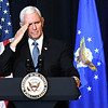 Vice president Mike Pence salutes during a memorial service honoring Chuck Yeager at the Charleston Coliseum Convention Center Friday afternoon. On October 14, 1947, Yeager became the first man to fly faster than the speed of sound thus enabling mankind to go into space. Yeager died last month at the age of 97.<br /> (Rick Barbero/The Register-Herald