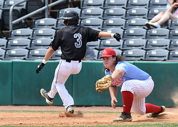 Nikholas Tobin, of North Marion, beats out a throw at first base grabbed by Andrew Lester, of Independence, during the semi-final State Baseball Tournament held at Appalachian Power Park in Charleston Friday morning.<br /> (Rick Barbero/The Register-Herald)