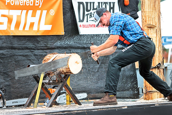 Lumberjack Mike Pakos competes in a log sawing competition at the Timberworks Lumberjack Show at the State Fair of West Virginia Thursday. Jenny Harnish/The Register-Herald