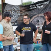 Matt Deal of Bluefield and Bill Fraley of Athens, Nick Durm the Snowman from 93.5 and Lola Rizer enjoy a few drinks from the Weathered Ground Brewery Sunday evening during the Beer Festival uptown Beckley. <br /> Tina Laney/for The Register-Herald