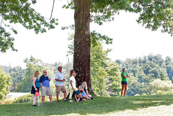 Spectators watch as golfers make their way to the 15th hole of the Old White course during the 102nd West Virginia Amateur at The Greenbrier in White Sulphur Springs Wednesday.  Jenny Harnish/The Register-Herald