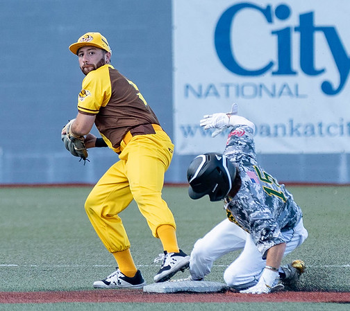 Jeremy Iellimo with the Johnstown Mill Rats gets the lead runner Jack Reifsnyder with the WV Miners out at  2nd.<br /> Tina Laney/for The Register-Herald