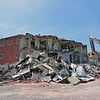 Workers demolish the old jail house behind the Greenbrier County Courthouse in Lewisburg Tuesday. The building is being razed to make way for a courthouse annex. Jenny Harnish for the Register-Herald