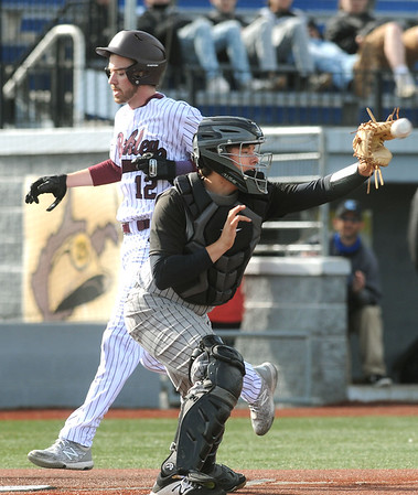 Woodrow's Cooper Vaught scores ahead of a throw to Lincoln County catcher, Drew McCloud. Jon C. Hancock/for The Register-Herald