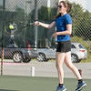 Angela Sundstrom makes contact with the tennis ball during the summer league championships at Woodrow Wilson High School. Chad Foreman for the Register-Herald.