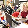 Cydney Jordan, title one teacher, left and Haley Lane, special education, at Jumping Branch Elementary School, works up lession for remote learning in the schools classroom. <br /> (Rick Barbero/The Register-Herald)