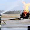 Fire fighters from Beaver Fire Department and Raleigh County Memorial Airport, put out a fire on a simulator airplane during a training exercise held at the Raleigh County Memorial Airport in Beaver Wednesday morning. <br /> (Rick Barbero/The Register-Herald)