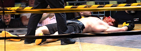 Christopher Barbera K/O Zachary Mills during the Toughman Contest Saturday night.  <br /> Tina Laney/for The Register-Herald