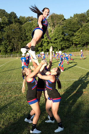 Midland Trail cheerleaders practice their stunt routines before the game begins. Chad Foreman for the Register-Herald.