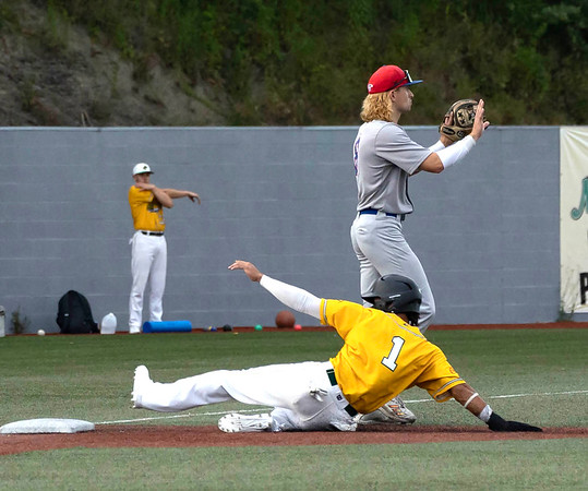 Kenneth Melendez for the WV Miners slides safely into 3rd base while Tryben Funderbury for the Champion City Kings awaits the throw.<br /> Tina Laney/for The Register-Herald