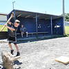 Bentley Rose, 9, played for the Braves in the Miner League at Shady Spring Little League, breaks away concrete from a post the league is salvaging to use when they locate a place for new field. They are moving  after 43 seasons due to the expasion of Shady Spring Elementary School.<br /> (Rick Barbero)