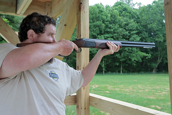 Shooting range specialist Brandon Buckland demonstrates skeet shooting at the new Adventure Zone in Pipestem Resort State Park Saturday. The Adventure Zone offers 3D Archery, Miniature Golf, Disc Golf, Remote-Controlled Cars and Trucks, Drone Flying, Laser Tag, Skeet Shooting and Motor Assisted Mountain Bikes. The Adventure Zone is open seven days a week and all equipment is provided. Jenny Harnish for the Register-Herald