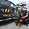 Sgt. Rick Talley with Raleigh County Sheriff Department and his 4 1/2 year old bloodhound Smokey who recently was awarded K-9 team of the Year by the WV Police K-9 Association. <br /> (Rick Barbero/The Register-Herald)
