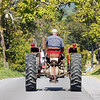 A member of the Tahoe Tractor Club drives down Blue Sulphur Road during the Antique Tractor Ride in the Alderson area Saturday. Jenny Harnish/The Register-Herald