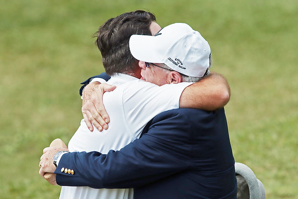 Philip Reale hugs his father and West Virginia Golf Association President Phillip Reale after winning the 102nd West Virginia Amateur on the Old White course at The Greenbrier in White Sulphur Springs Wednesday.   Jenny Harnish/ The Register-Herald
