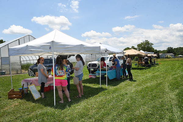 Local farmers set up at New Roots Community Farm on 167 Wolf Creek Road in Fayetteville. The Farm host an open farm market every Thursday from 1-6 p.m.<br /> (Rick Barbero/The Register-Herald)