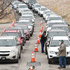 Vehicles line up during  a drive-thru COVID-19 vaccine clinic held Friday, January 8 from 9:00am-3:00pm at the Beckley Raleigh County Convention Center. The clinic provided 650 vaccines for 80 and over population of Raleigh County.<br /> (Rick Barbero/The Register-Herald)