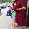Theresa Lewis, principal Crescent Elementary School, hugs Jenna Fitzwater, 3rd grade, at the entrance of the gym during parent drop off Tuesday morning for the first day of school in Raleigh County.<br /> (Rick Barbero/The Register-Herald)