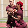 Woodrow Wilson quarterback Maddex McMillen hands off the ball to teammate Nate Grayton during the first day of three-week period Monday. Jenny Harnish/The Register-Herald
