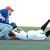 Brent Widder for Champion City Kings tags out Juan Familia for the WV Miners while trying to steal 2nd base.<br /> Tina Laney/for The Register-Herald