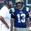 Shady Spring QB Cameron Manns discussing the next play with Coach Vince Culicerto during the game Friday night against Tug Valley.<br /> Tina Laney/for The Register-Herald