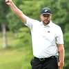 Davey Jude reacts after almost sinking a birdie putt on the par 5, 18th hole during the final round of the Mountain State Golf Classic held on the Cobb course Monday. Jude won the tournament with a 3 under par.<br /> (Rick Barbero/The Register-Herald)