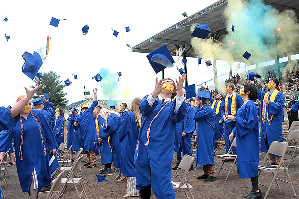 Greenbrier West High School graduation throw their hats in the air after receiving their diplomas at the 2021 commencement ceremony in Fairlea Saturday.  Jenny Harnish for the Register-Herald