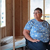Dottie Fisher sits in her new home in Hope Village in White Sulphur Springs Thursday. Fisher's home was destroyed by a fire and Storm-Aid, the Amish group that constructed the houses in the wake of the flood - has come to rebuild it. Jenny Harnish for the Register-Herald