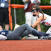 Alyvia Pittman, of Ritchie County slides save under tag from Chezney Skaggs, of Midland Trail, during the Class A State Softball Tournament held at Little Creek Park in South Charleston.<br /> (Rick Barbero/The Register-Herald)