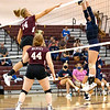 Olivia Ziolkowski for Woodrow Wilson High School battles at the net with Kyra Davis for Independence High School Tuesday night. <br /> Tina Laney/for The Register-Herald