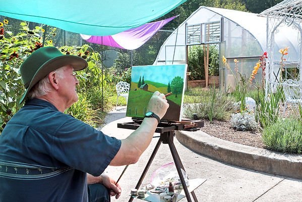 The Greenbrier Artists member John Telisko met fellow artists at Jardin by the River for a paint-out day in Ronceverte Tuesday. The group, which has about 90 members, usually meets at Carnegie Hall but schedule outings during the summer months. Visitors and new members are welcome at all meetings. Jenny Harnish/The Register-Herald