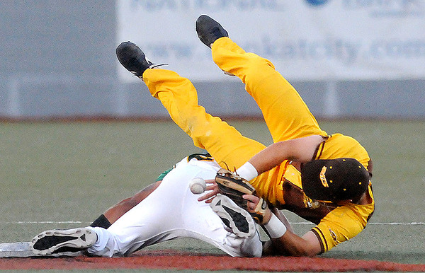 Johnstown Millrats second baseman Danian Yenzi is up ended by Miners Malik Williams as he steals second base. Jon C. Hancock/for the Register-Herald
