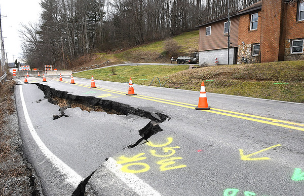 Road collapsed on the 700 block of Prosperity Road.<br /> (Rick Barbero/The Register-Herald)