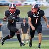 Oak Hill's Leonard Farrow (8) looks to run as Omar Lewis (1) during their high school football game against Lincoln County in Oak Hill on Friday. (Chris Jackson)