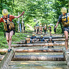 Girl Scout Hannah Bacskay, left, and Francesca Taracila test their balance on the mud course on Monday at Ace Adventure Resort. F. Brian Ferguson/Register-Herald