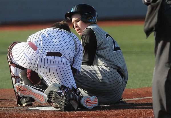 Woodrow catcher Blake Stratton tags out Lincoln county's Brayden Starcher during a play at the plate. Jon C. Hancock/for The Register-Herald
