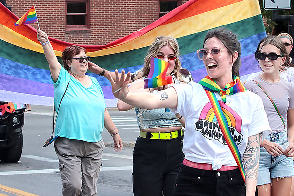Participants wave in the Inaugural Greenbrier Valley Pride parade in downtown Lewisburg Saturday.  Jenny Harnish for the Register-Herald