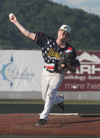 Miners pitcher Steve Bowley throws toward the plate during a game with the Johnstown Millrats. Jon C. Hancock/for the Register-Herald