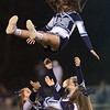 Wildcat chearleaders perform a hair-raising acrobatic stunt. Chad Foreman for the Register-Herald.