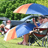 Kay Pata, left and Ben Disibbio, of Bluefield, shades themselves from the hot sun during the Class AA-A Region 3 high school tennis tournament held at Shady Spring High School.<br /> (Rick Barbero/The Register-Herald)