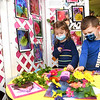 Addie Dale, left, and Edge Hampton, both students in Jane Atinson, pre-k class at St. Francis de Sales school in Beckley, look over the Georgia O'Keffe exhibit they helped create for their annual fund raising art gallery that's on display in the school. Atinson said, this was a two month project with students producing 400 pieces of art that are displayed in 15 seperate exhibits. Members of the church, staff members, students. parents and grandparents are able to view the gallery Thursday and Friday in the parish hall between 8 am and 2:30 p.m. and can purchase a piece of artwork in a frame for $10.  The fund raiser helps to buy art supplies and other activities.<br /> (Rick Barbero/The Register-Herald)